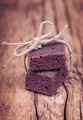 Chocolate brownie mini bites with sting ribbons on a old wooden - PhotoDune Item for Sale
