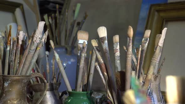 Artist's art tools in the art studio. Oil painting in creative workroom