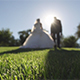 Wedding Couple Walking on the Green Grass in the Sun - VideoHive Item for Sale