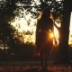 Joyful Girl Runs Through the Sun in Autumn Park in During Sunset - VideoHive Item for Sale
