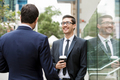 Two businessmen talking outdoors - PhotoDune Item for Sale