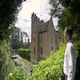 Man strolls up and views a historical castle - VideoHive Item for Sale