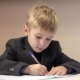 Serious Boy Writing On His Notebook - VideoHive Item for Sale