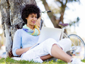 Woman working outdoors in a meadow with laptop - PhotoDune Item for Sale