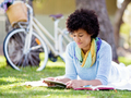 Young woman using tablet in the park. - PhotoDune Item for Sale