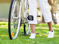 Happy young woman with bicycle - PhotoDune Item for Sale