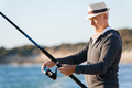 Senior man fishing at sea side - PhotoDune Item for Sale