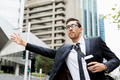 Young businessmen hailing for a taxi - PhotoDune Item for Sale