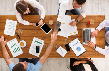 Business people group handshake in office, top view