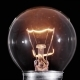 Edison Lamp Light Bulb Blinking Over Black Background - VideoHive Item for Sale