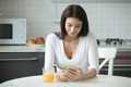 Portrait of smiling woman with smartphone having healthy lunch - PhotoDune Item for Sale