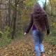 Young, Beautiful Woman with Long Hair Walking in the Autumn Forest - VideoHive Item for Sale