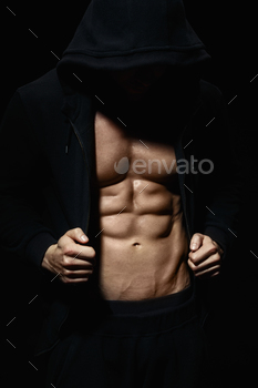Strong athletic man showes muscular body