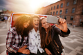Three young friends taking selfie on tricycle ride. - PhotoDune Item for Sale