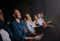 Happy young friends watching movie in cinema. - PhotoDune Item for Sale