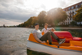 Teenage boys boating on the lake in city - PhotoDune Item for Sale
