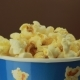 Salty Popcorn Slowly Rotates on Brown Background - VideoHive Item for Sale