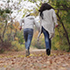 Mother and Son in the Park in Autumn Running Around - VideoHive Item for Sale