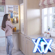 Young Woman With Apple In Hand In Front Of Fridge - VideoHive Item for Sale