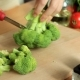 Female Hands Cut Broccoli Into Florets - VideoHive Item for Sale