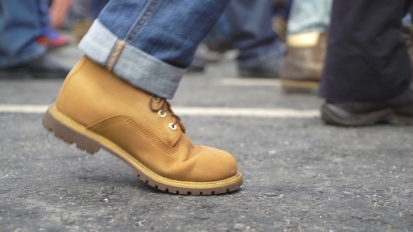 Concept Crowd Feet with Shoes . Anonymous People Walking on the Street.