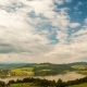 of Moving Clouds Over a Lake and a Village in a Mountain Valley - VideoHive Item for Sale