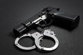 Handgun with handcuffs - PhotoDune Item for Sale