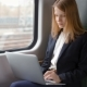 Young Business Woman Goes By Train, Works on a Laptop and Looks at the Window - VideoHive Item for Sale
