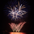 Firework over the water in the night sky - PhotoDune Item for Sale