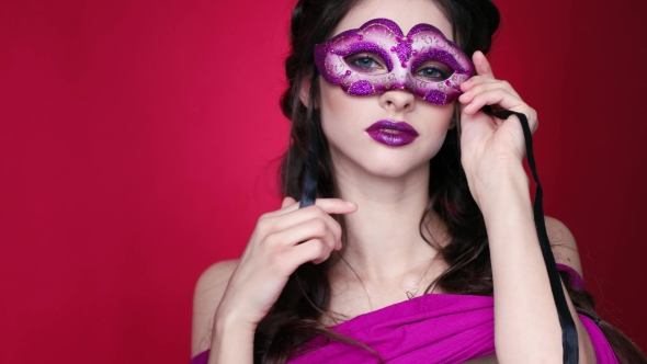Gorgeous Model with Glamorous Make-up in Carnival Glasses