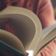 Man Leafing Through a Large Book - VideoHive Item for Sale