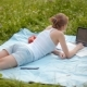 Nice Student Girl Is Studying in Park with Laptop and Notebook inSummer on Grass - VideoHive Item for Sale