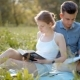 Young Beautiful Couple Reading Books Outdoors in Summer at Picnic with Sun Light - VideoHive Item for Sale