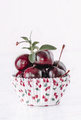 fresh red cherries on a white paper shape - PhotoDune Item for Sale