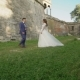 Lovely Wedding Couple Coming To Each Other and Embraces at Castle - VideoHive Item for Sale
