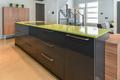 Modern kitchen with green quartz island close-up - PhotoDune Item for Sale