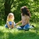 Happy Young Brunette Mother with Little Cute Daughter with Blonde Curly Hair Resting Outdoors in the - VideoHive Item for Sale