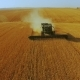 Front Aerial View of Modern Combine Harvester Gathers the Wheat Crop - VideoHive Item for Sale