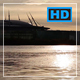 Large Massive Building on the Water Shoreline. Reflected Sun from the Surface of the Water - VideoHive Item for Sale