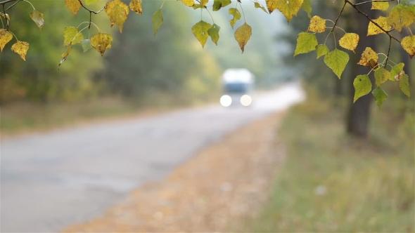 Autumn Landscape. Transport Moves Along the Road.