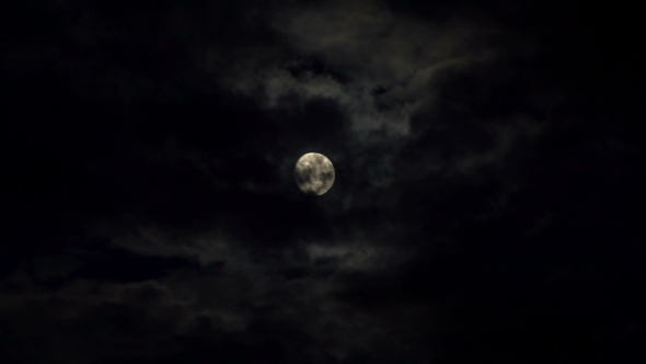 Clouds Passing By Moon at Night