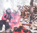 Couple near bonfire in winter landscape - PhotoDune Item for Sale