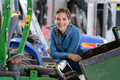 smiling woman in a mechanical workshop - PhotoDune Item for Sale