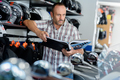 man browsing motorbike catalog - PhotoDune Item for Sale