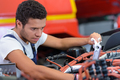 young man trying to repair a car engine - PhotoDune Item for Sale
