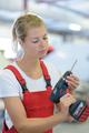 cute woman at work using drilling machine - PhotoDune Item for Sale