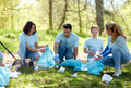 volunteers with garbage bags cleaning park area - PhotoDune Item for Sale