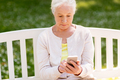 senior woman with smartphone at summer park - PhotoDune Item for Sale