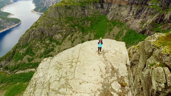 Girl Is Standing on the Edge of the Trolltunga