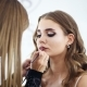 Beautiful Make-up Artist Applying Makeup To a Model in the Class and Explaining - VideoHive Item for Sale